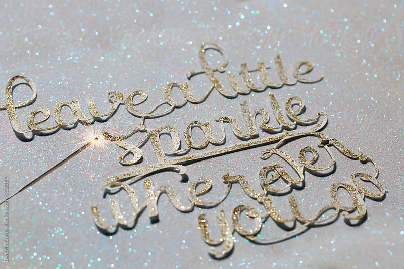 Wise message with sparkler on glitter background by Beatrix Boros for Stocksy United