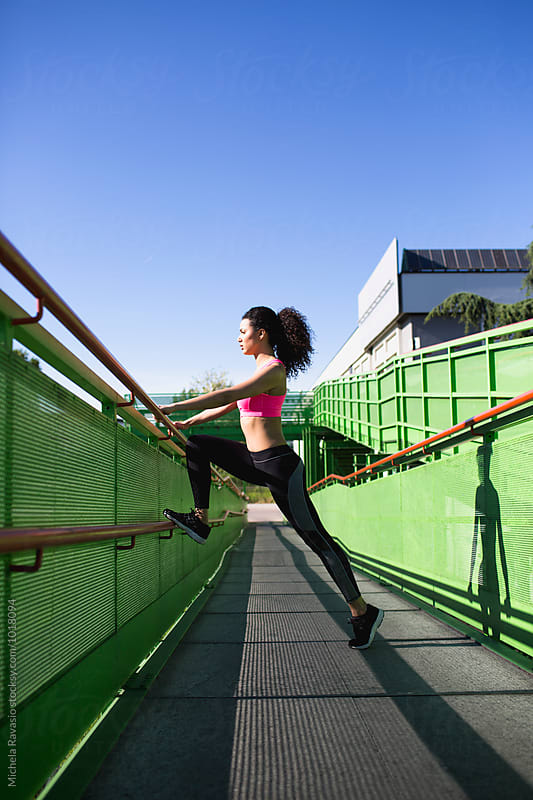 Woman fitness training outdoors by michela ravasio for Stocksy United