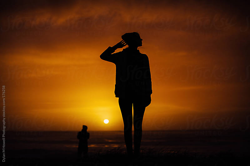 girl silhouette at sunset by Dylan M Howell Photography for Stocksy United
