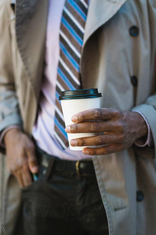Businessman outfit details with coffee cup in hand by GIC for Stocksy United