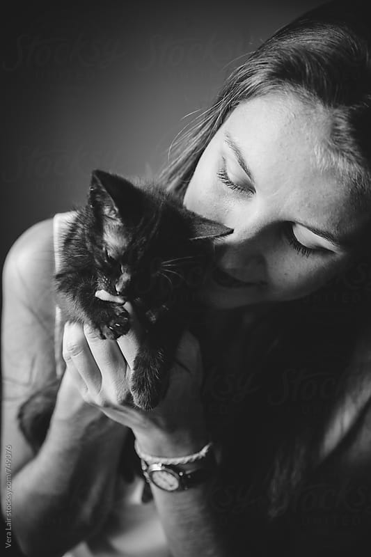 Cat with her human by Vera Lair for Stocksy United