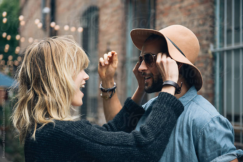 Seeing how her hat and glasses look on him by Emmanuel Hidalgo for Stocksy United