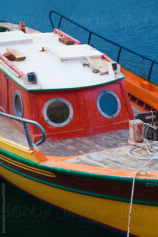 colorful boat at the sea by Sonja Lekovic for Stocksy United