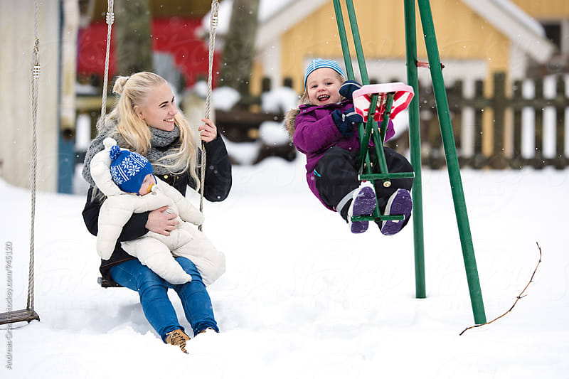 winter fun at the playground by Andreas Gradin for Stocksy United