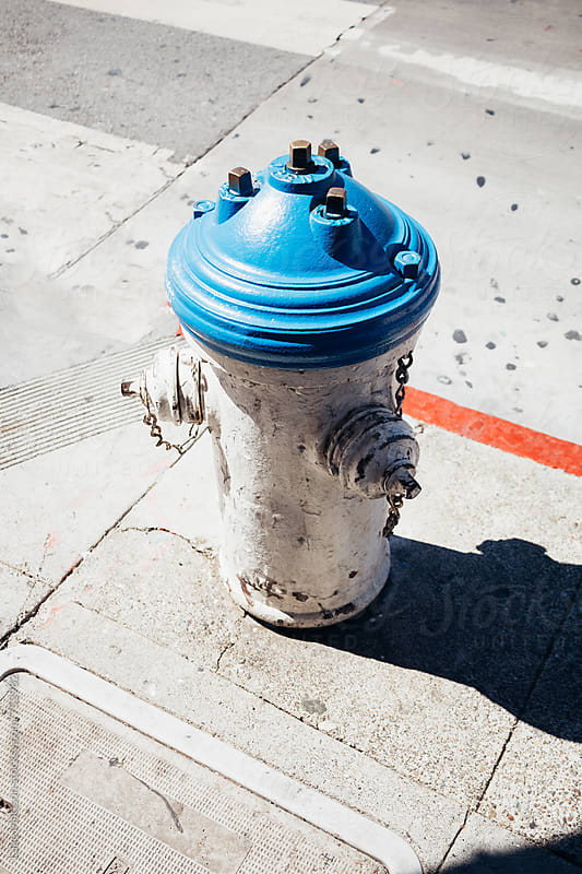 City Fire Hydrant On Corner of Sidewalk Along Street by Luke Mattson for Stocksy United