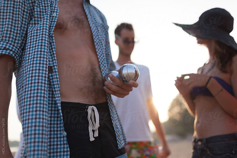 Man Holding a Bocce Ball During The Game by HEX. for Stocksy United