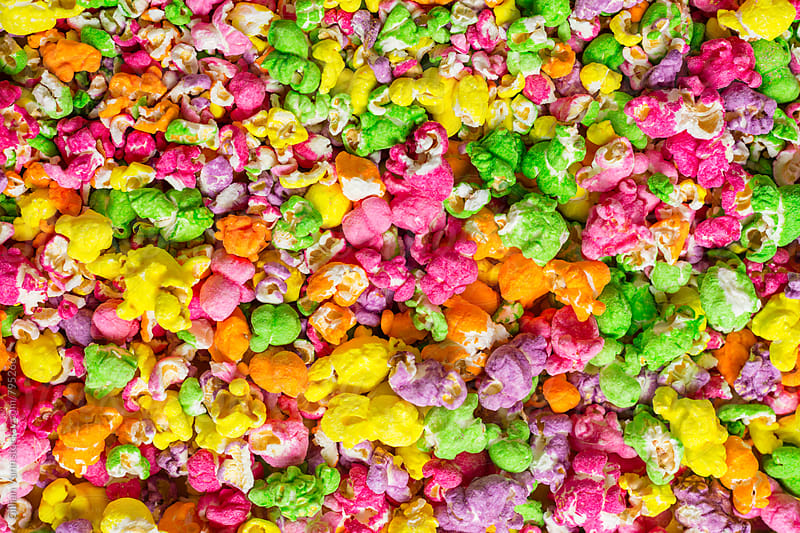 background of rainbow sugar popcorn by Gillian Vann for Stocksy United