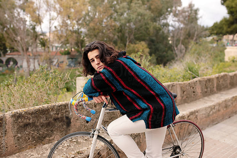 Young boy resting on his bike by Lucas Ottone for Stocksy United