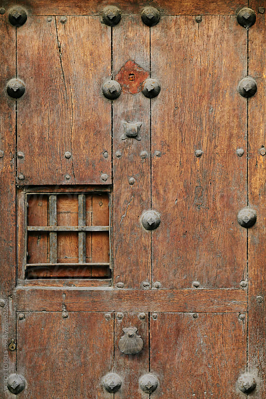 Grunge Wooden Door Background by VICTOR TORRES for Stocksy United