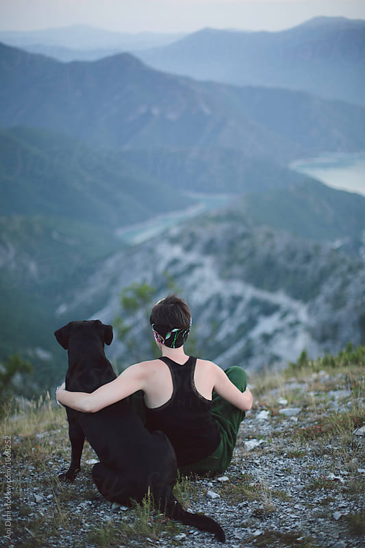 Woman with her pet enjoying the mountain view  by Ani Dimi for Stocksy United