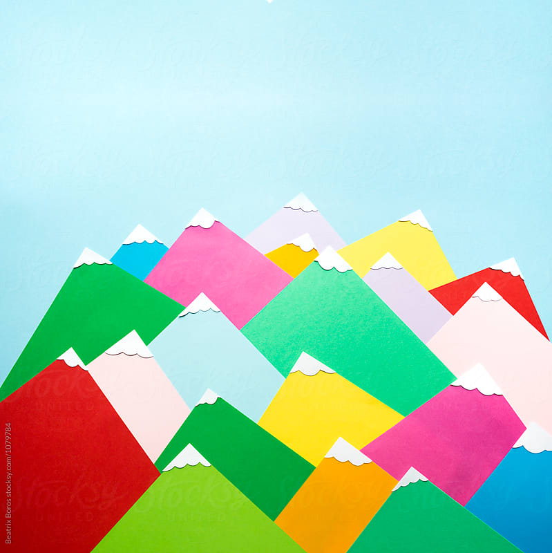 Several colorful mountains made of paper by Beatrix Boros for Stocksy United