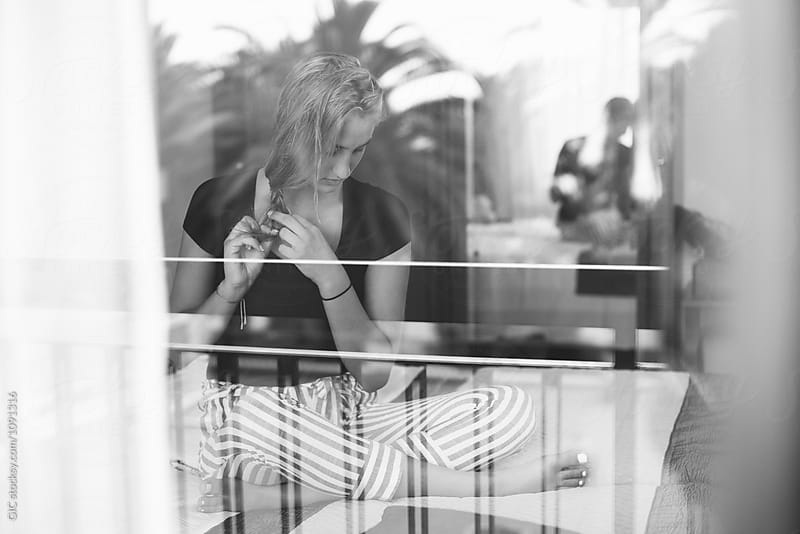 Young woman portrait between mirror and window by GIC for Stocksy United