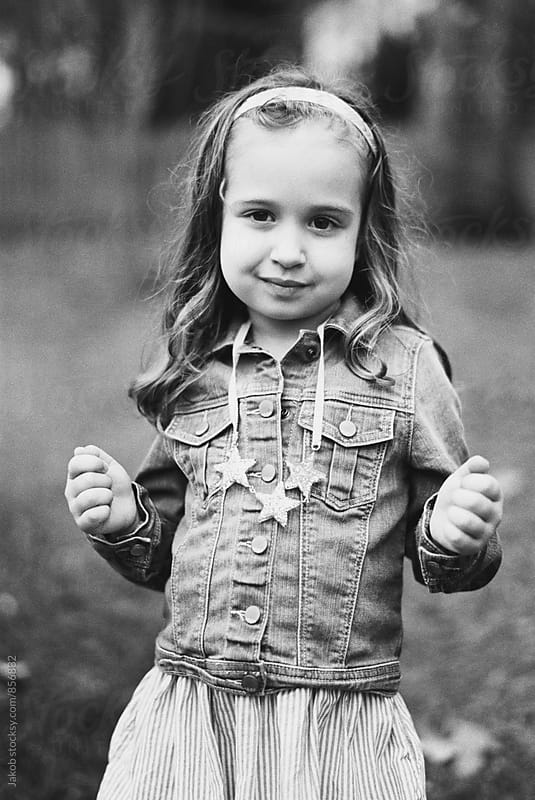 Black and white portrait of a beautiful young girl in a denim jacket by Jakob for Stocksy United