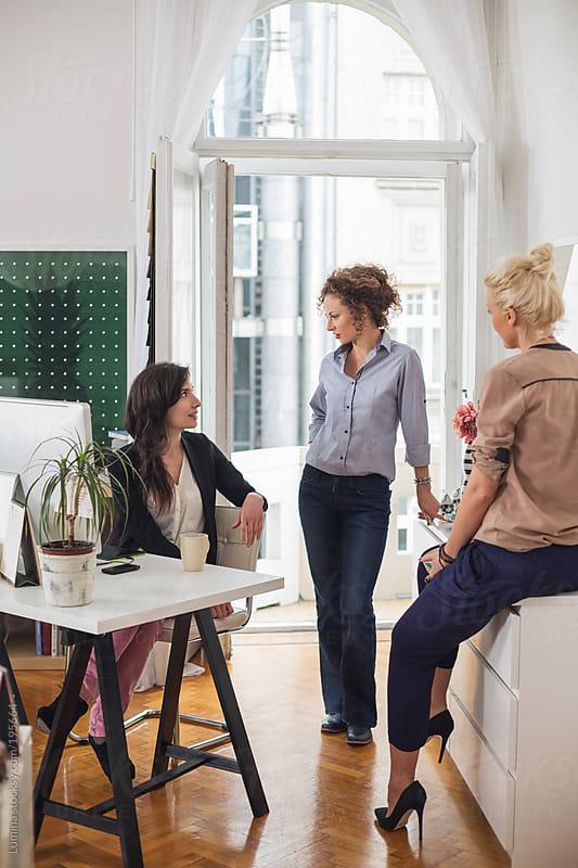 Businesswomen Talking by Lumina for Stocksy United
