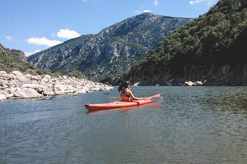 Woman kayaking in Cedrino lake, Sardinia, Italy by Luca Pierro for Stocksy United