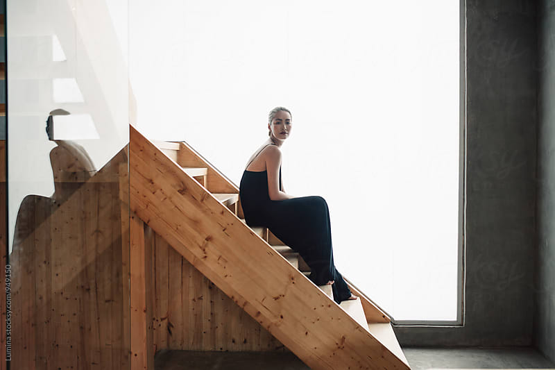 Asian Fashion Model Posing on the Wooden Stairs by Lumina for Stocksy United
