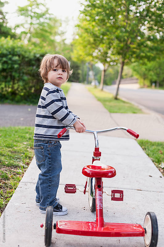 A Boy And His First Tricycle by Cameron Whitman for Stocksy United