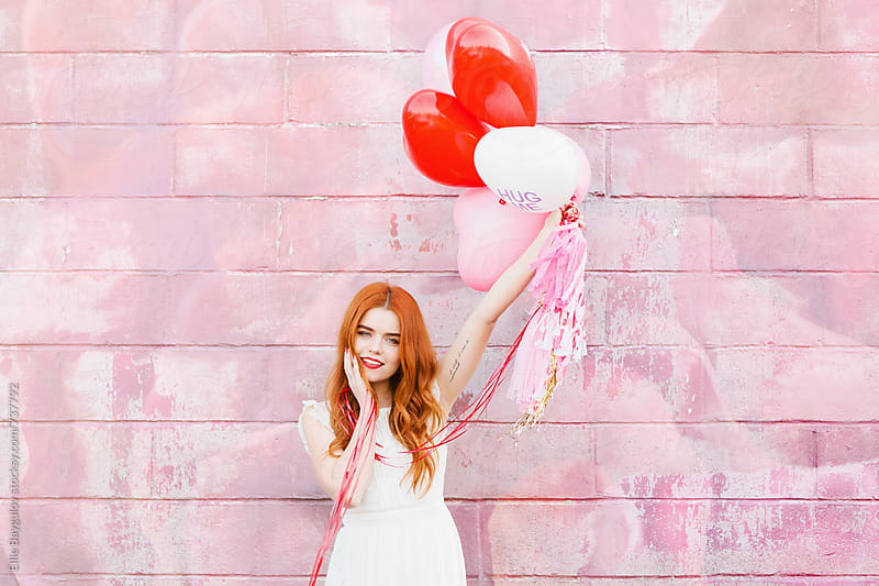 Redhead girl with balloons by Ellie Baygulov for Stocksy United