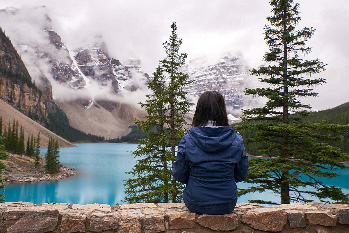 Woman Enjoying The Snowy Landscape And The Beauty Turquoise
