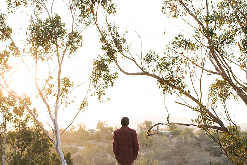 Man Overlooks A Sunset by Caleb Thal for Stocksy United