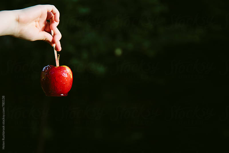 A toffee apple. by Helen Rushbrook for Stocksy United