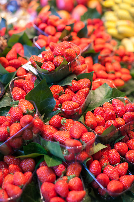 Strawberries for sale at local market by Zocky for Stocksy United
