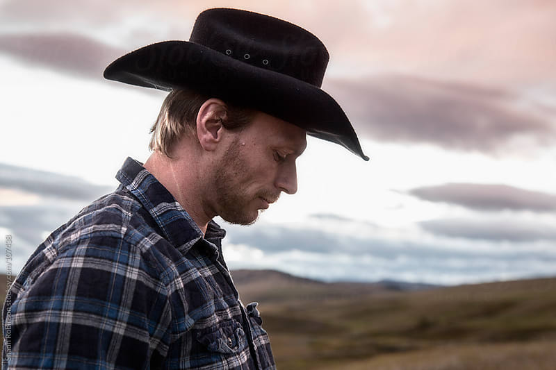 cowboy, man, sunset, hat, country, plaid,  portrait, rugged by Shaun Robinson for Stocksy United