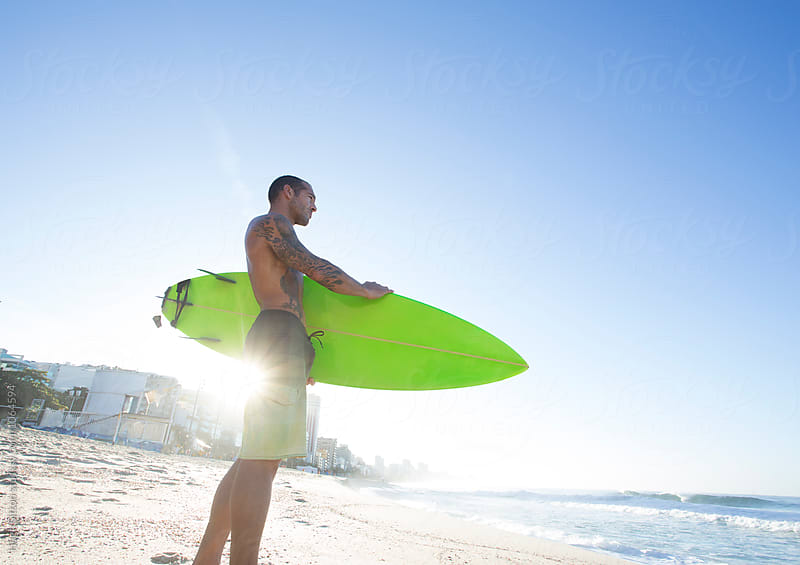 Surfer. Ipanema Beach. Rio de Janeiro, Brazil.  by Hugh Sitton for Stocksy United