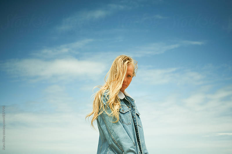 Blonde girl, blue skies by Kara Riley for Stocksy United
