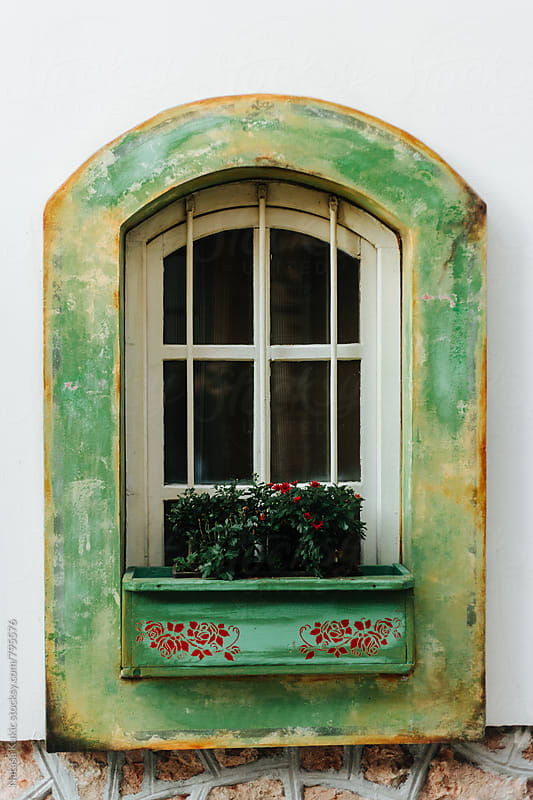 Green window by Natasa Kukic for Stocksy United
