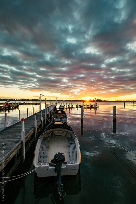 Boats tied up to a Jetty in Metung, Australia by Gary Radler Photography for Stocksy United