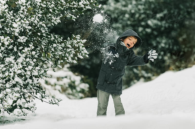 Child hit by snowball by Rebecca Spencer for Stocksy United