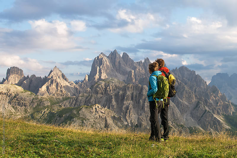 Couple looking at the view of Dolomites Mountains by RG&B Images for Stocksy United