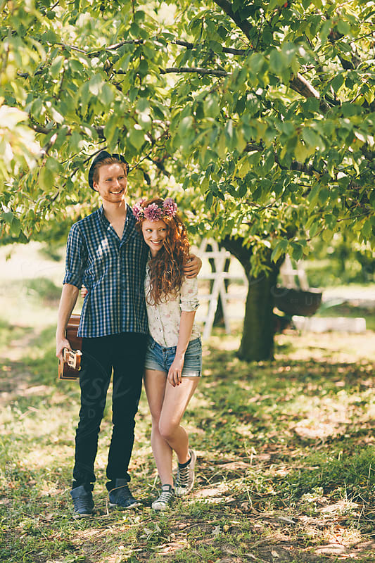 Happy Couple in an Orchard by Lumina for Stocksy United