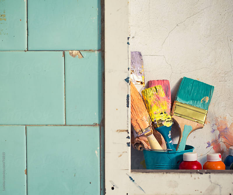 Bunch of Paintbrushes Beside a Tiled Wall by Lumina for Stocksy United