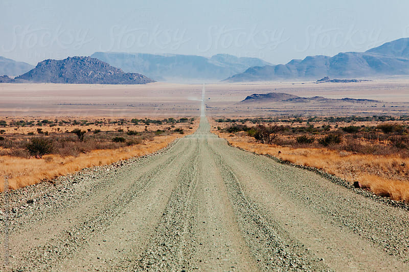 Long empty desert road in Namibia by Micky Wiswedel for Stocksy United