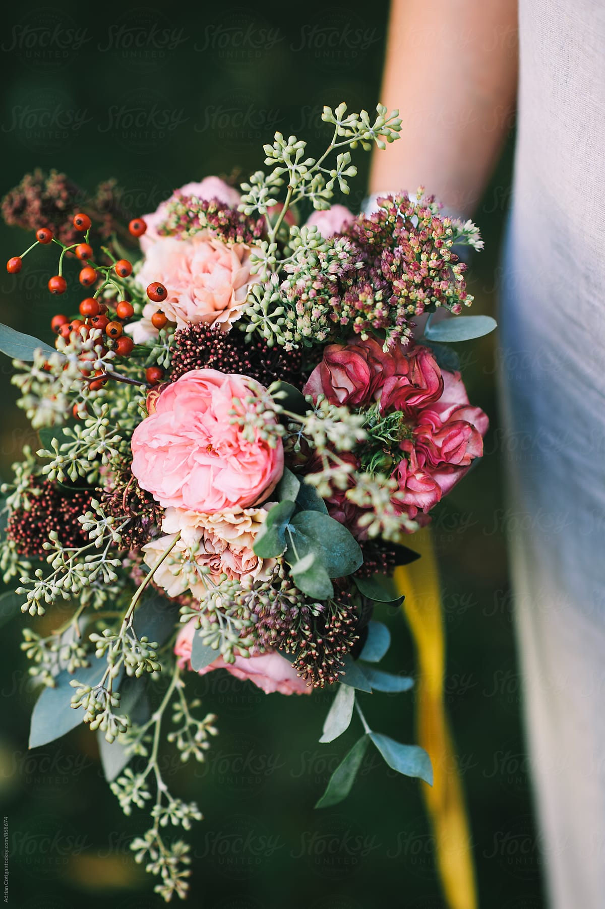 Woman Holding A Lovely Bouquet Of Pink Peonies And Eucalyptus By Adrian Cotiga Stocksy United