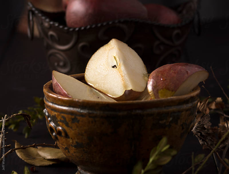 Bowl of Anjou Pear Slices with Maple  Syrup Glaze by Jeff Wasserman for Stocksy United