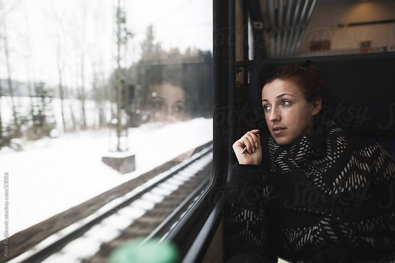 Travelling by train by Amir Kaljikovic for Stocksy United