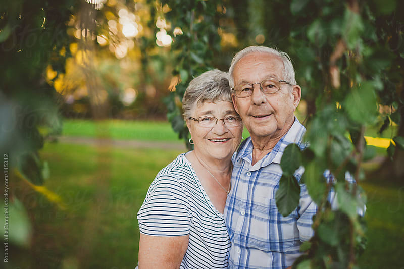 Cute elderly couple smiling together outside by Rob and Julia Campbell for Stocksy United
