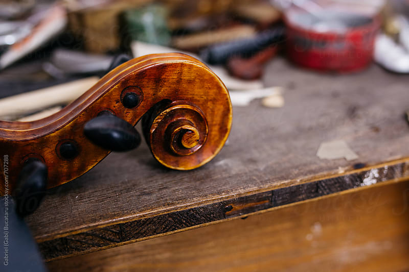 Violin scroll on a workbench by Gabriel (Gabi) Bucataru for Stocksy United