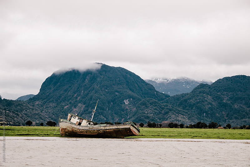 Abandoned ship at Port Chacabuco, Chile by Justin Mullet for Stocksy United