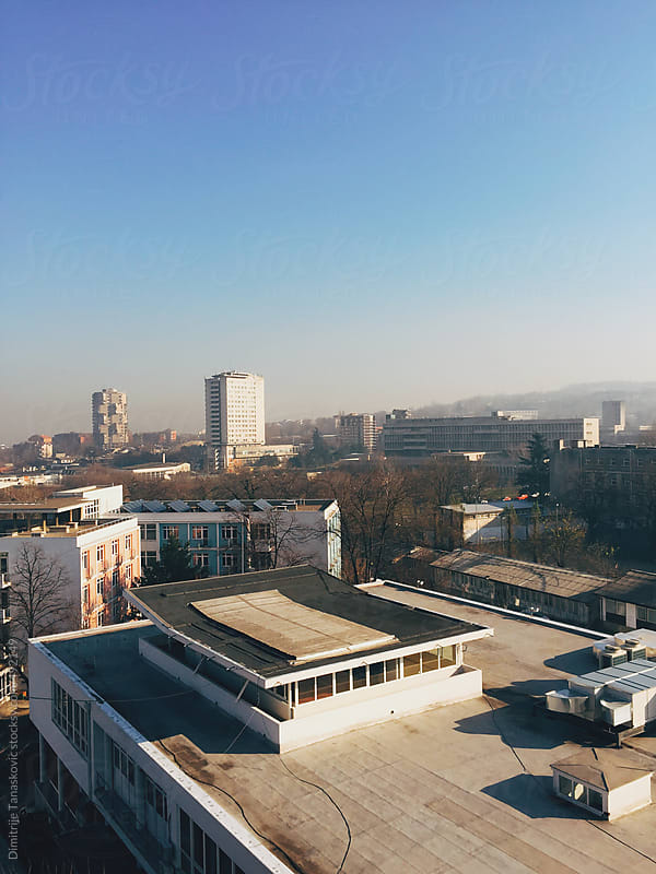 Clear blue sky above the city in the morning by Dimitrije Tanaskovic for Stocksy United