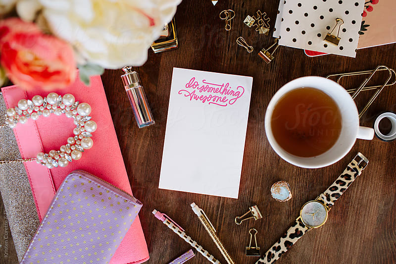A notepad surrounded by women accessories and blogging tools.  by Kristen Curette Hines for Stocksy United