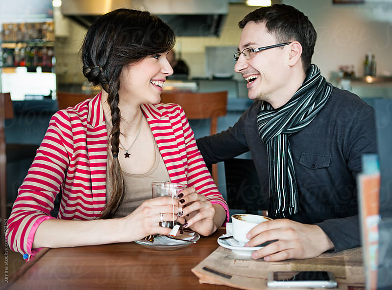 Smiling Couple Enjoying at a Cafe by Lumina for Stocksy United