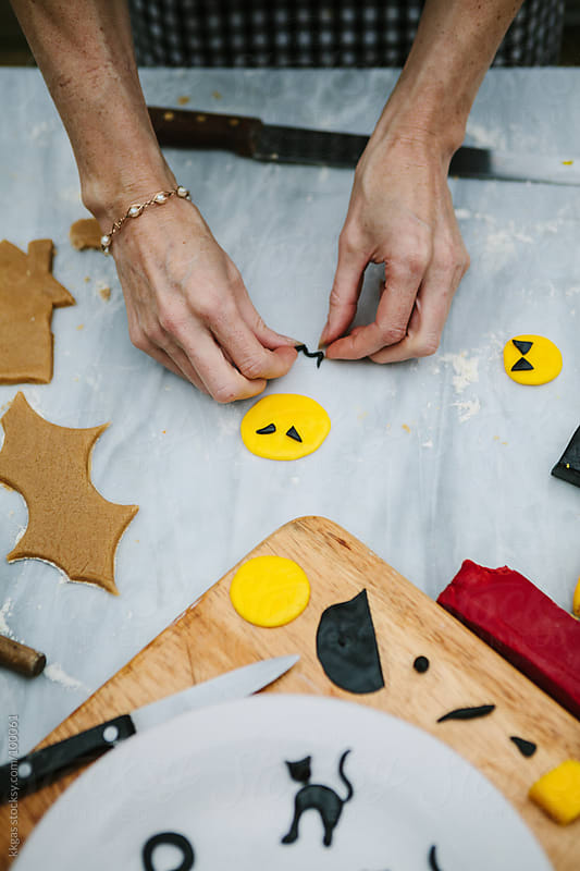 Making Halloween icing decorations by kkgas for Stocksy United