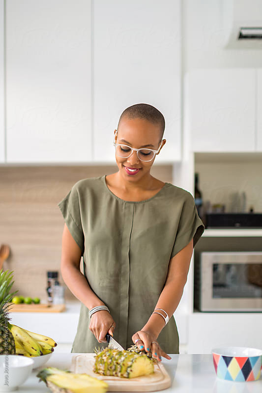 Beautiful black woman preparing healthy snacks by Jovo Jovanovic for Stocksy United
