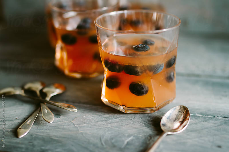 Fruit jellies with blueberries. by Helen Rushbrook for Stocksy United