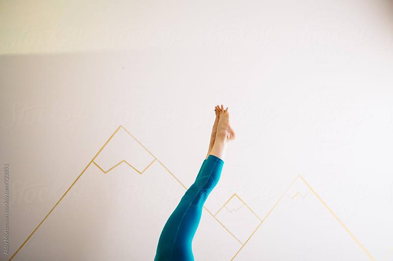 Yogi Feet in the Air by Abby Mortenson for Stocksy United