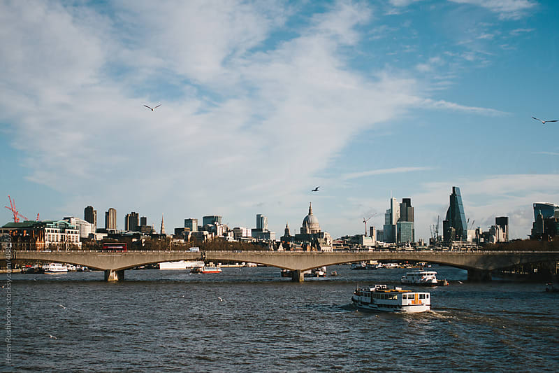 The River Thames and The skyline of The City of London by Helen Rushbrook for Stocksy United